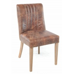 Leather covered dining chair with solid wood legs and stylish distressing to the leather