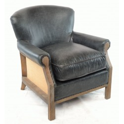 A traditionally shaped chair with a dark leather cover and hessian sides over a solid wood and legs