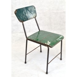 Dining style chair made from recycled oil drums