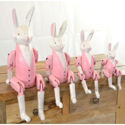 Set of 4 rabbits with pink clothing to sit on a shelf with jointed legs hanging over the edge