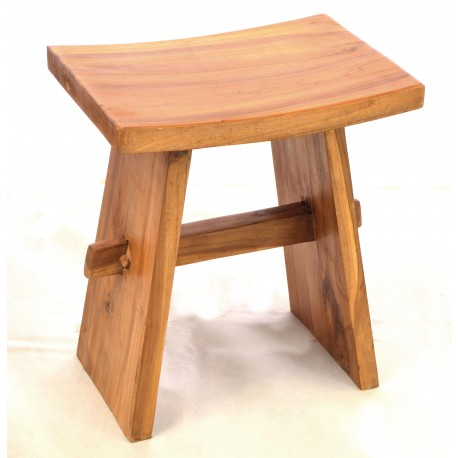 Saddle stool made from solid teak with a saddle seat and pinned bracing bar