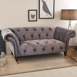 Velvet covered chesterfield design of sofa, fabric is a deep grey coloured very soft velvet