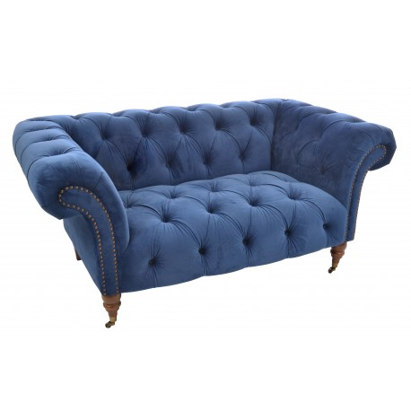 Velvet covered chesterfield design of sofa, fabric is a deep blue coloured very soft velvet
