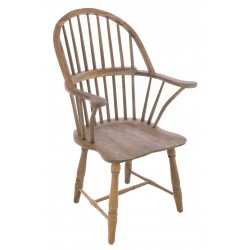 Solid wood carver chair in a windsor continuous arm style with a vintage stripped back finish