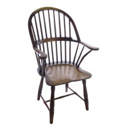 Solid wood carver chair in a windsor continuous arm style with a dark wood polished finish
