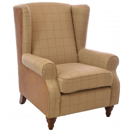 Tall wing back chair with tweed pattern fabric seat and faux leather back on a solid wood frame