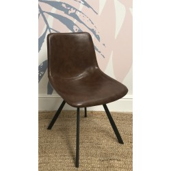 Modern style faux leather chair with black painted metal angled leg frame