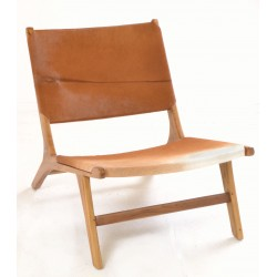 Easy chair with a cow hide seat, back and solid teak frame