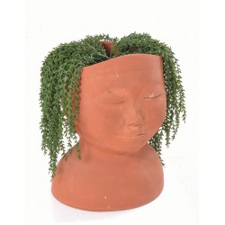 Hand made terracotta pot in the style of a bust with an unglazed finish