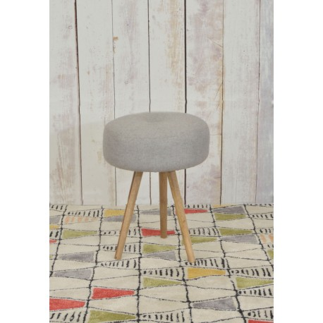 Upholstered round stool with deep padding and three straight turned legs set at an angle
