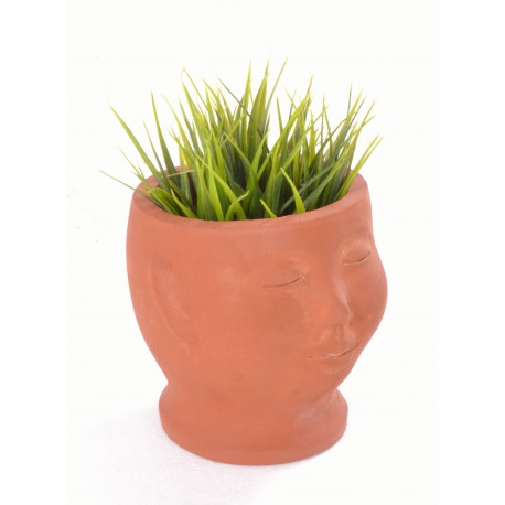 Hand made terracotta plant pot in the style of a small bust with a unglazed finish