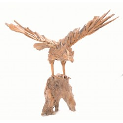 Ornamental eagle on a low stand made from reclaimed teak pieces and put together to create the eagle