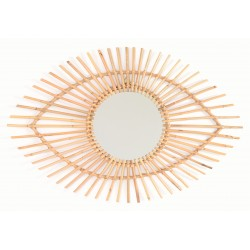 Round mirror with a woven natural finish rattan frame in the shape of an stylised eye