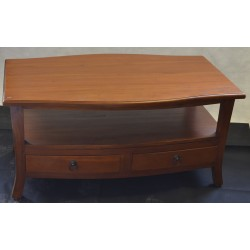 Solid mahogany coffee table with some scratches and damage to the top