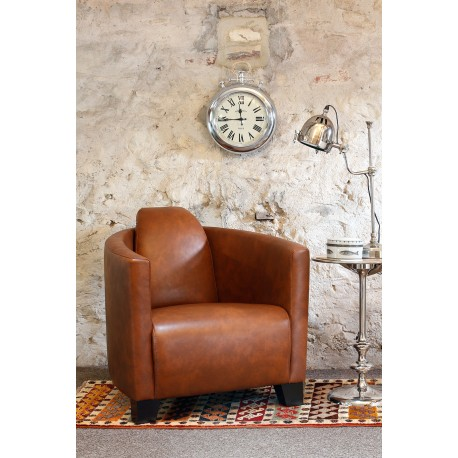 Leather Tub Chair in a light brown leather in Brando style with curving arms and large back cushion