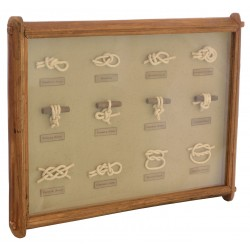A display board of various knots on green background in a reclaimed pine frame