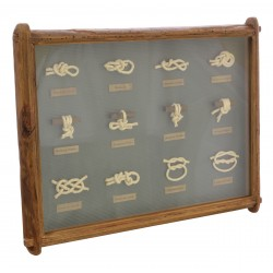 A display board of various knots on grey background in a reclaimed pine frame