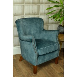 Deep Green Velvet small armchair with a solid wood frame under the soft velvet upholstery