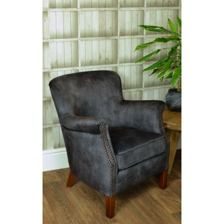 Charcoal Velvet small armchair with a solid wood frame under the soft velvet upholstery