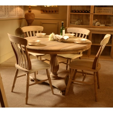 Round Dining Table with carved pedestal and triangular base and scroll feet in a stripped back wood finish