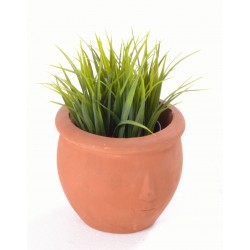 Hand made terracotta plant pot with a shallow stylised face