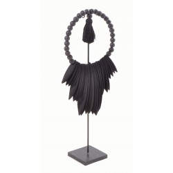 Black necklace on a wire stand with round beads and a centre piece of black spear shapes