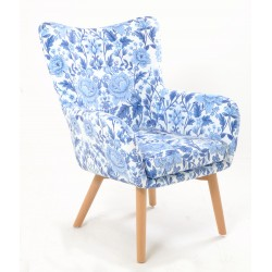 Stylish bedroom or occasional armchair with a blue and white flower pattern and retro style light brown legs