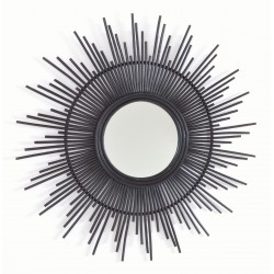 Round mirror with a sunburst frame made from rattan painted in striking black
