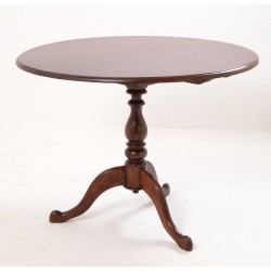 Solid Mahogany round dining table with lift up top secured with birdcage design on single pedestal and a dark finish